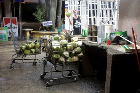 Felix – getting a fresh cut coconut after a long day shredding.